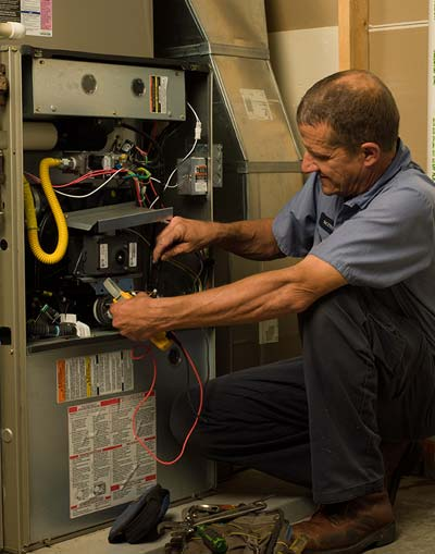 Dutch Enterprises technician working on unit